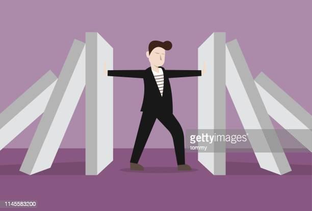 businessman fighting domino effect - domino effect stock illustrations