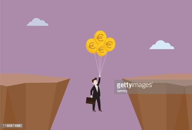 geschäftsmann schwebt zwischen einer klippe von euro-währungssymbol ballon - euro stock-grafiken, -clipart, -cartoons und -symbole