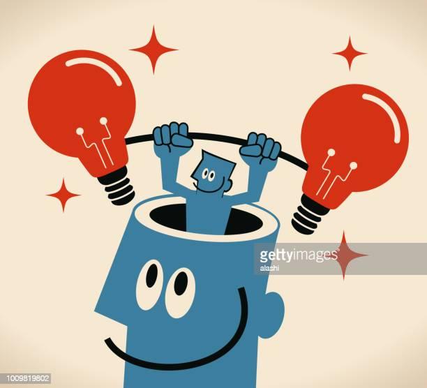 ilustraciones, imágenes clip art, dibujos animados e iconos de stock de empresario del hombre gigante abierto cabeza levantando dos idea bombilla - personas cabeza grande