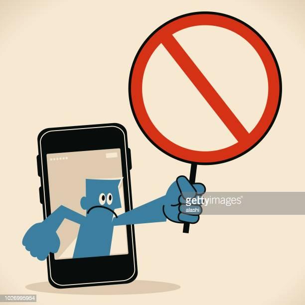 ilustrações de stock, clip art, desenhos animados e ícones de businessman from smart phone holding an empty prohibition sign - proibido celular