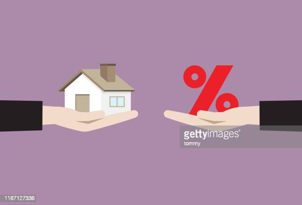 businessman hand holding house and percentage sign - mortgage loan stock illustrations