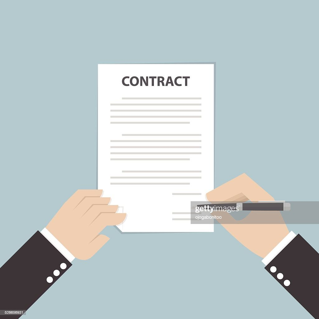 Businessman hand holding pen and signing business contract
