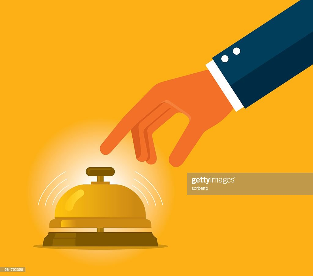 Businessman hand ringing in service bell