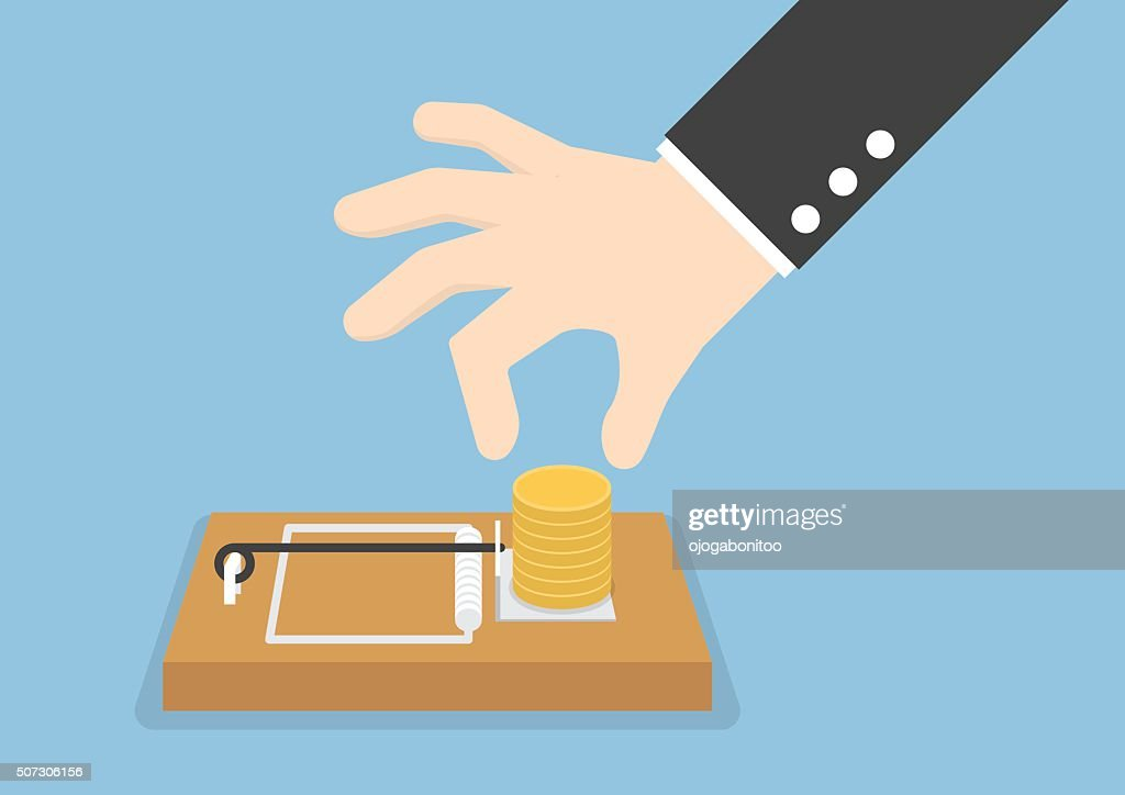 Businessman hand try to pick money from mousetrap