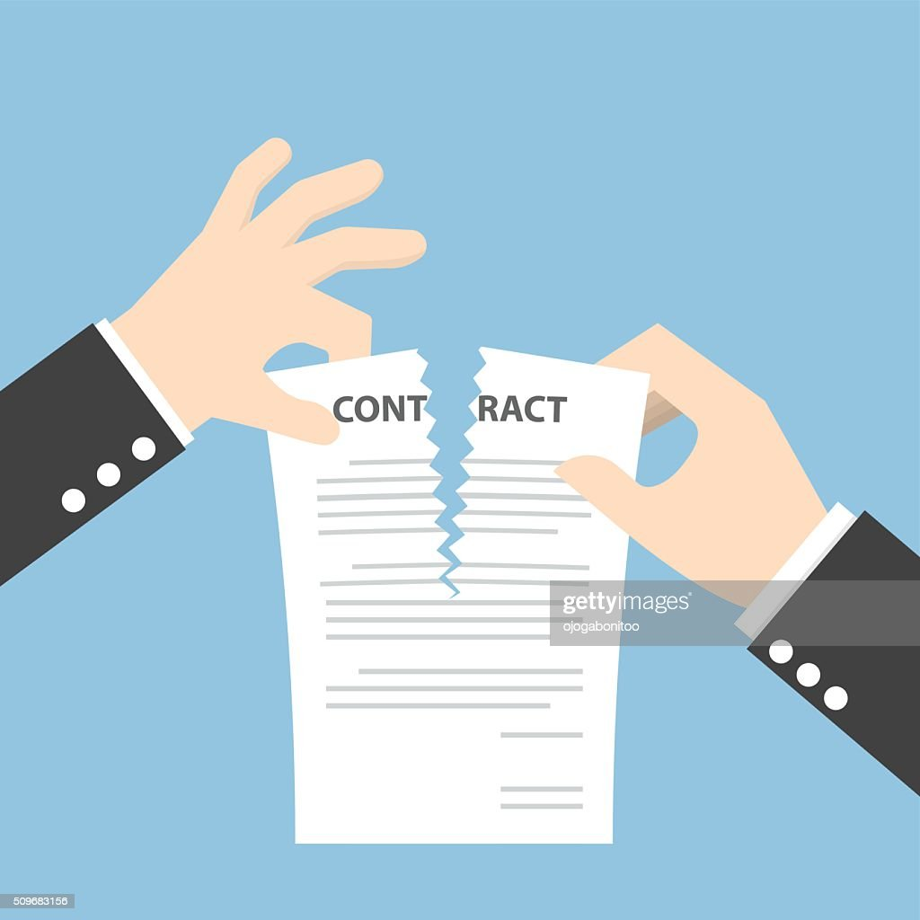 Businessman hands tearing apart contract document