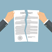 Businessman hands tearing apart contract in half