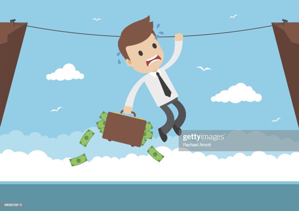 A businessman hanging from a rope