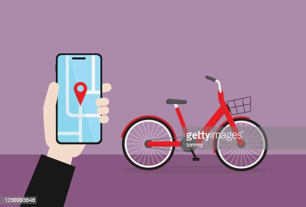 businessman hold a mobile phone for use a bicycle sharing - road marking stock illustrations