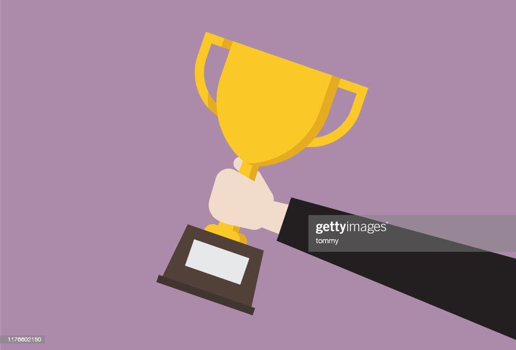 Businessman hold trophy : Stock Illustration