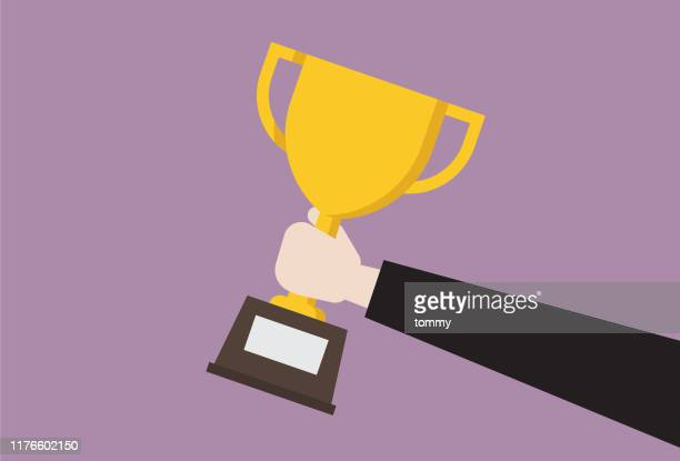 businessman hold trophy - success stock illustrations