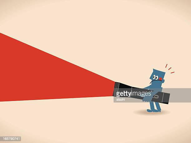 Businessman holding a big flashlight, searching somewhat, finding something
