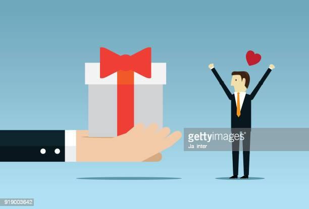 Zakenman die houdt een grote geschenkdoos