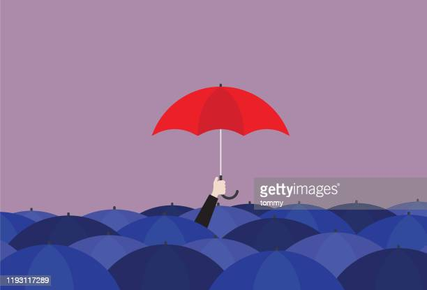 ilustrações de stock, clip art, desenhos animados e ícones de businessman holding a red umbrella in the crowd of a blue umbrella - chapéu