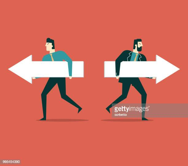 Businessman holding arrows to run in different directions