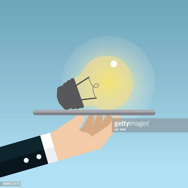 Businessman holding idea stock