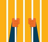 Businessman holding prison bars