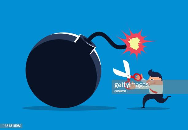 stockillustraties, clipart, cartoons en iconen met zakenman holding schaar af te snijden van de ontsteking lijn van de bom - bombardement