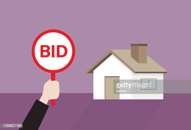 businessman holds a bid sign for auction a house - bid stock illustrations