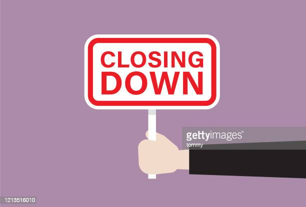 businessman holds a closing down sign - retail employee stock illustrations