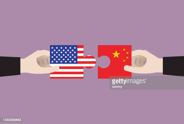 businessman holds a us and china jigsaw - global politics stock illustrations