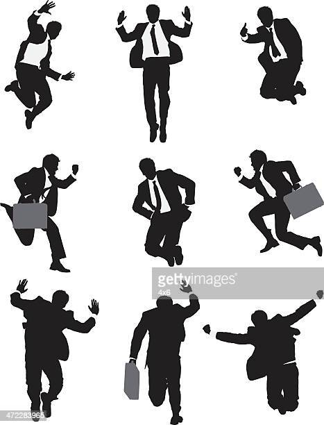 Businessman in suit jumping mid air poses