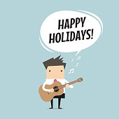 Businessman is playing a guitar and sing Happy Holidays.