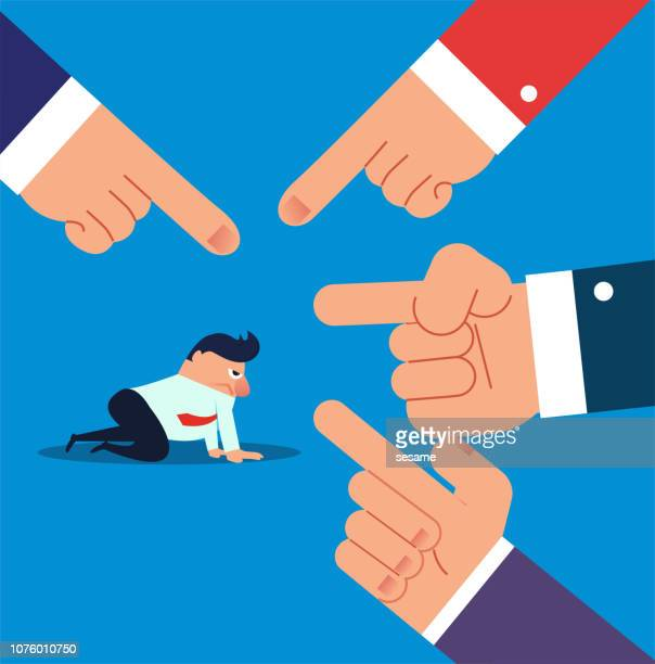 Businessman is pointed by four fingers