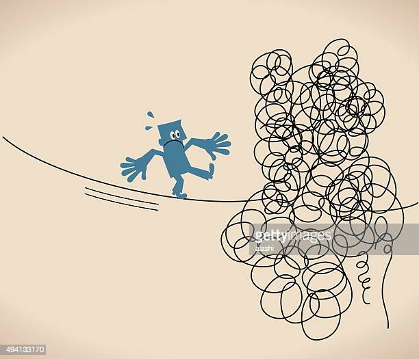 Businessman is walking on a tangled messy line (string, rope)