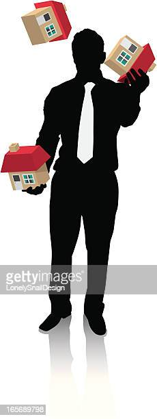 Businessman Juggling houses