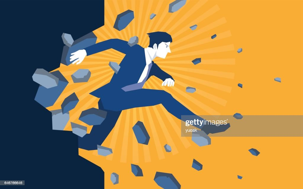 Businessman jump breaking the wall