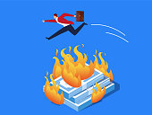 Businessman jumping over the fire of money