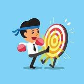 Businessman kicking a target