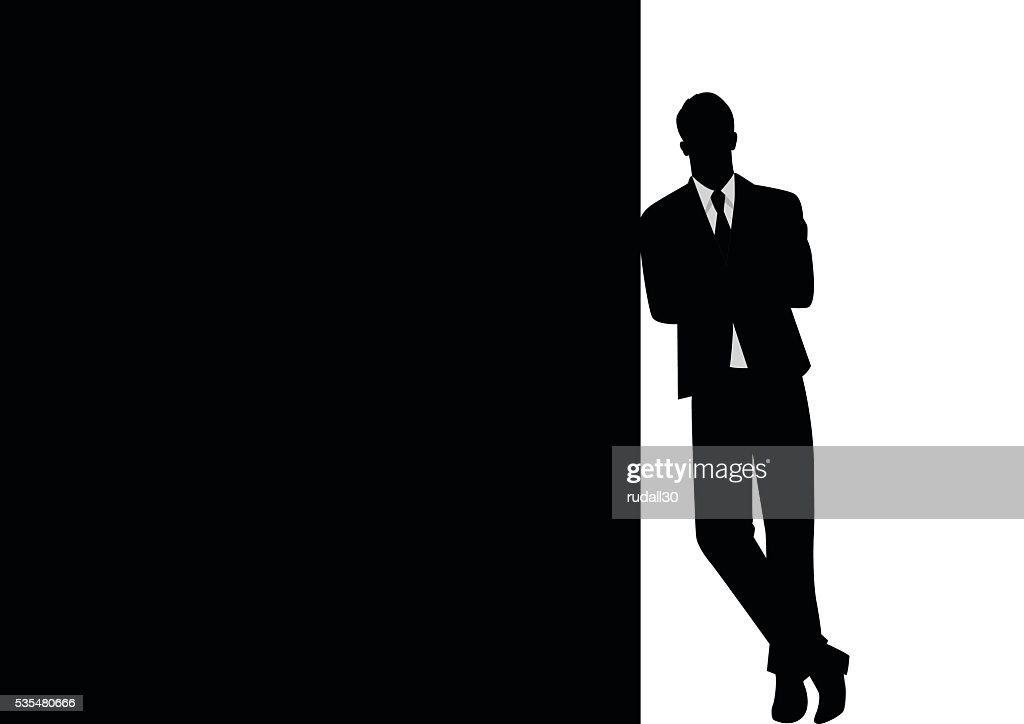 Businessman Leaning At Black Blank Space