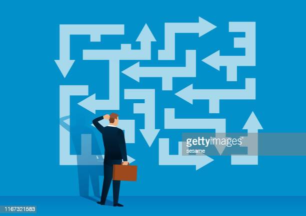 businessman looking at the labyrinth of arrows looking for the right direction - problems stock illustrations