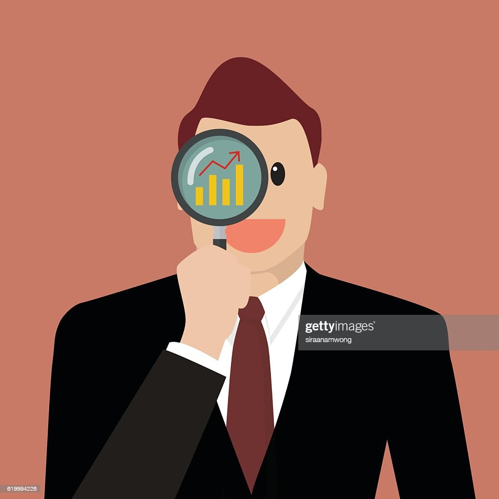 Businessman looking for business future through a magnifying gla
