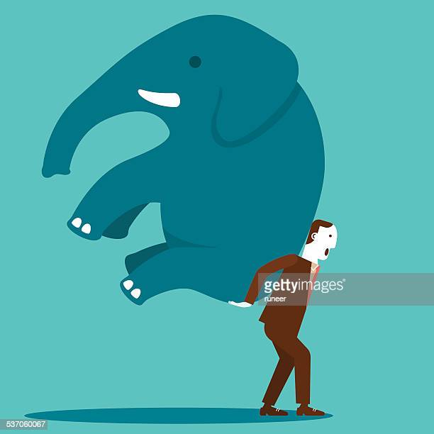 Businessman Moving An Elephant With Determination | New Business Concept