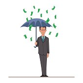 Businessman or manager with an umbrella in the rain of
