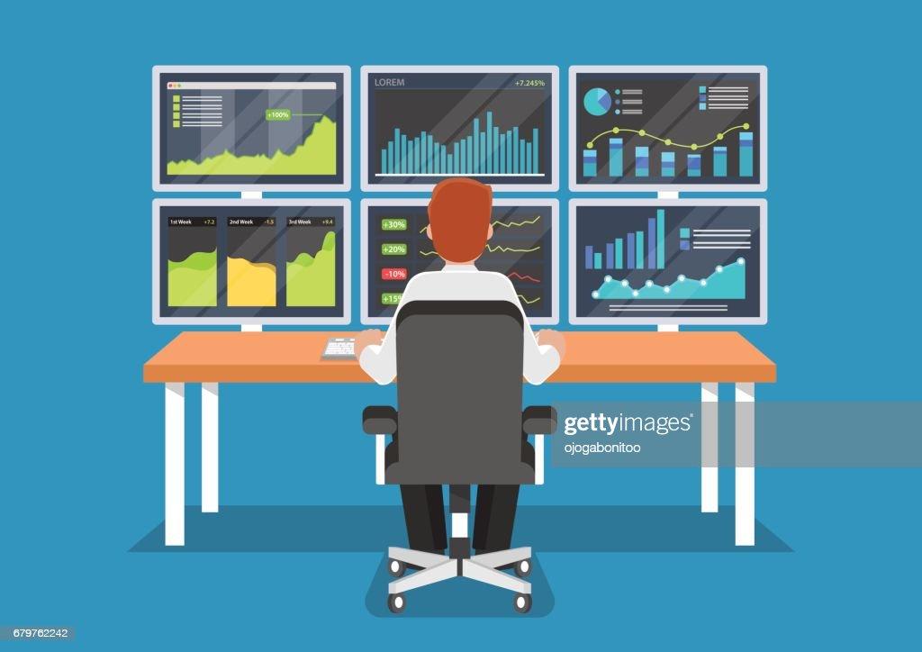 Businessman or stock market trader working at desk.