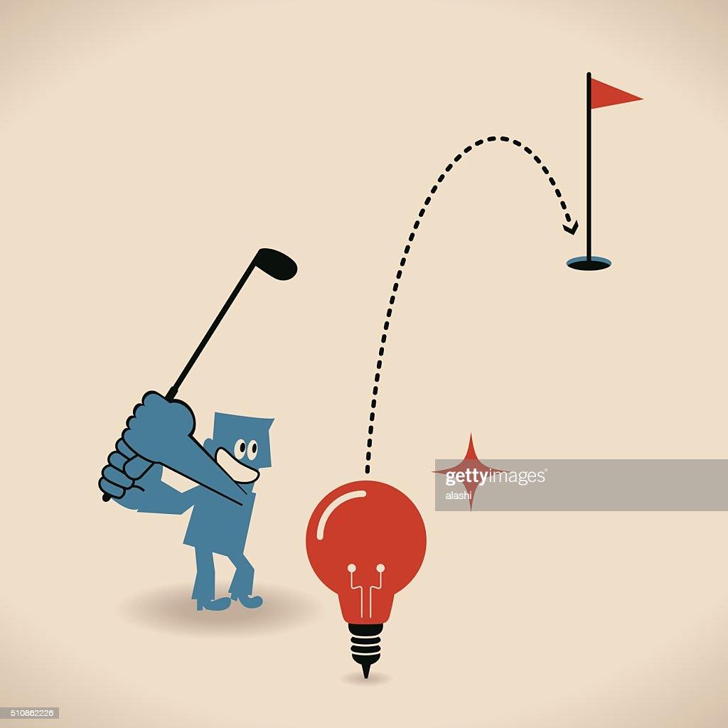 Businessman playing golf with idea light bulb, club, hole, flag