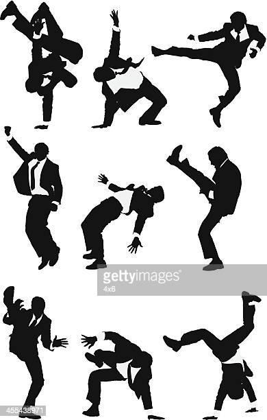 ilustrações de stock, clip art, desenhos animados e ícones de empresário praticar artes marciais - capoeira
