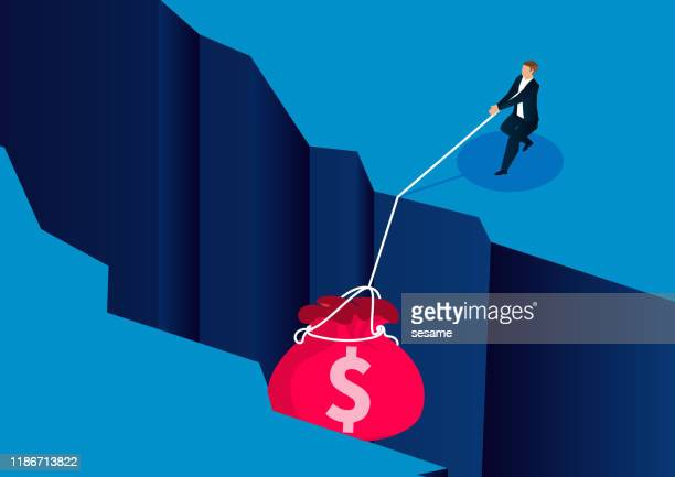 businessman pulling a money bag down the cliff - bailout stock illustrations