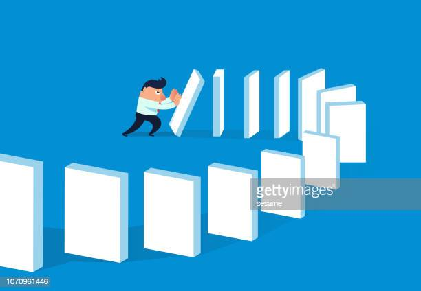 businessman pushed to dominoes - domino effect stock illustrations