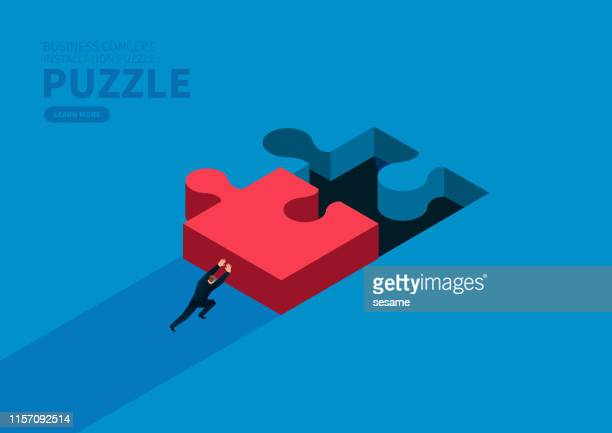 businessman pushes the puzzle to the right position - incomplete stock illustrations