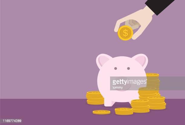 businessman putting dollar coin into a piggy bank - piggy bank stock illustrations