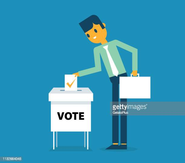 Businessman putting paper in the ballot box