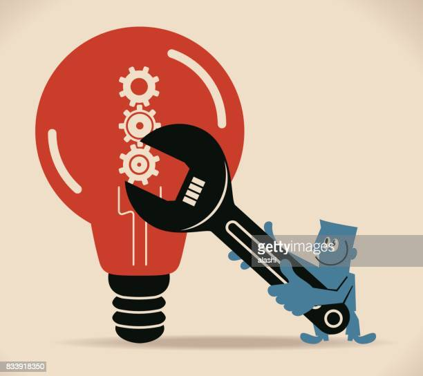Businessman (engineer, scientist) repairing a big idea light bulb with gear, using a huge wrench