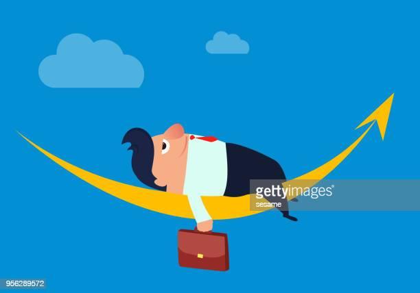 Businessman resting on arrow
