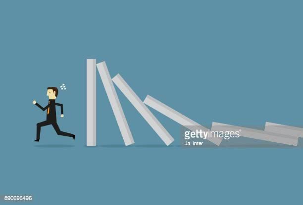 businessman runaway domino effect - domino effect stock illustrations
