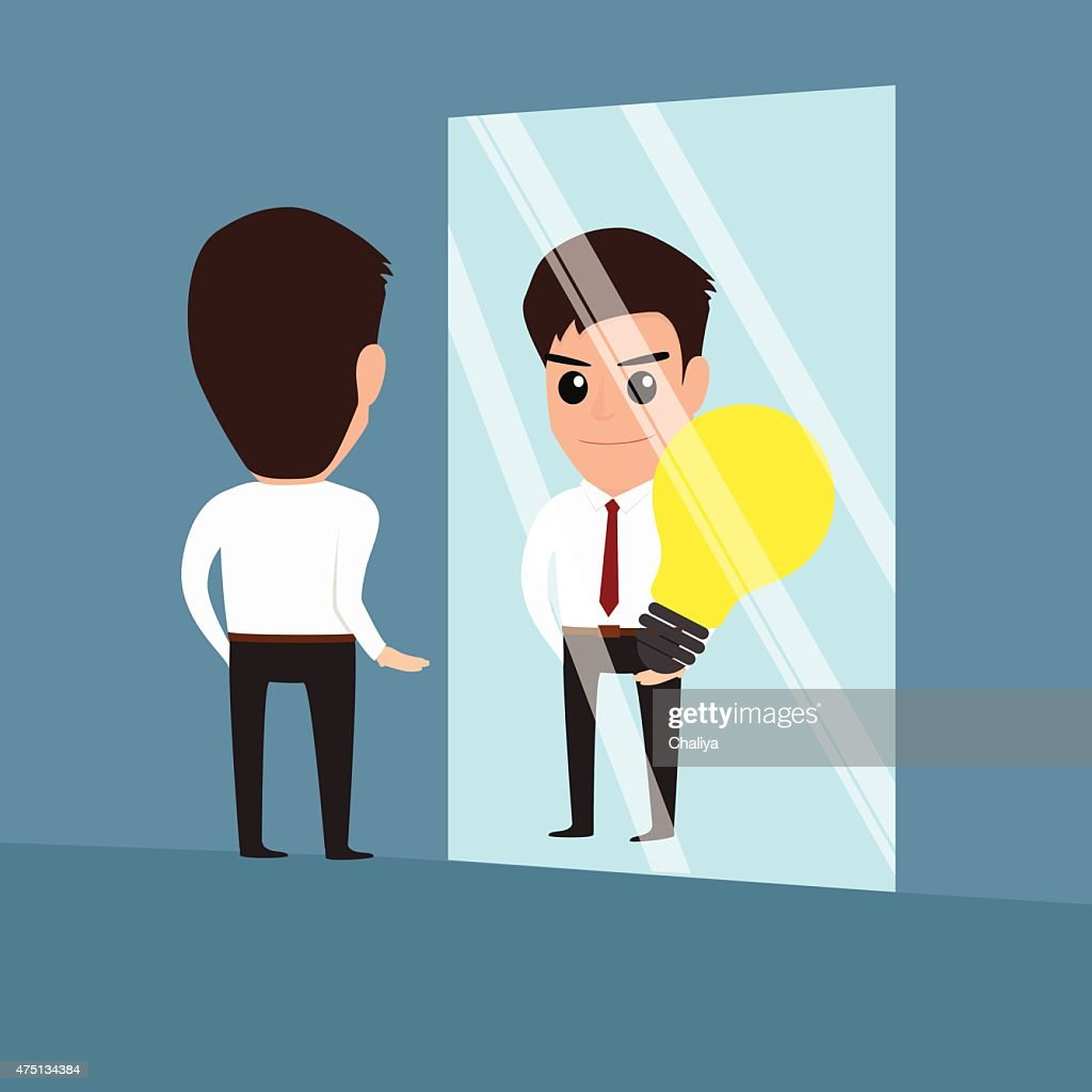 businessman see idea in the mirror