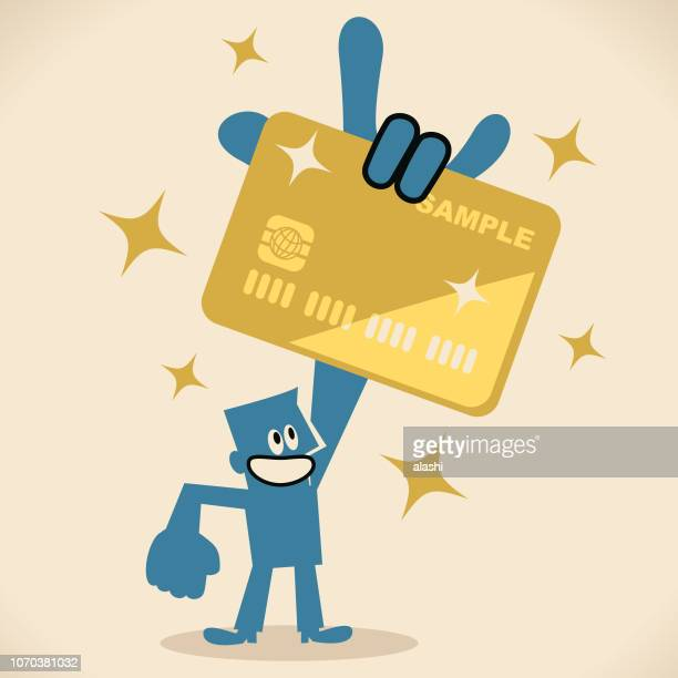 Businessman showing a huge credit card by rock hand sign